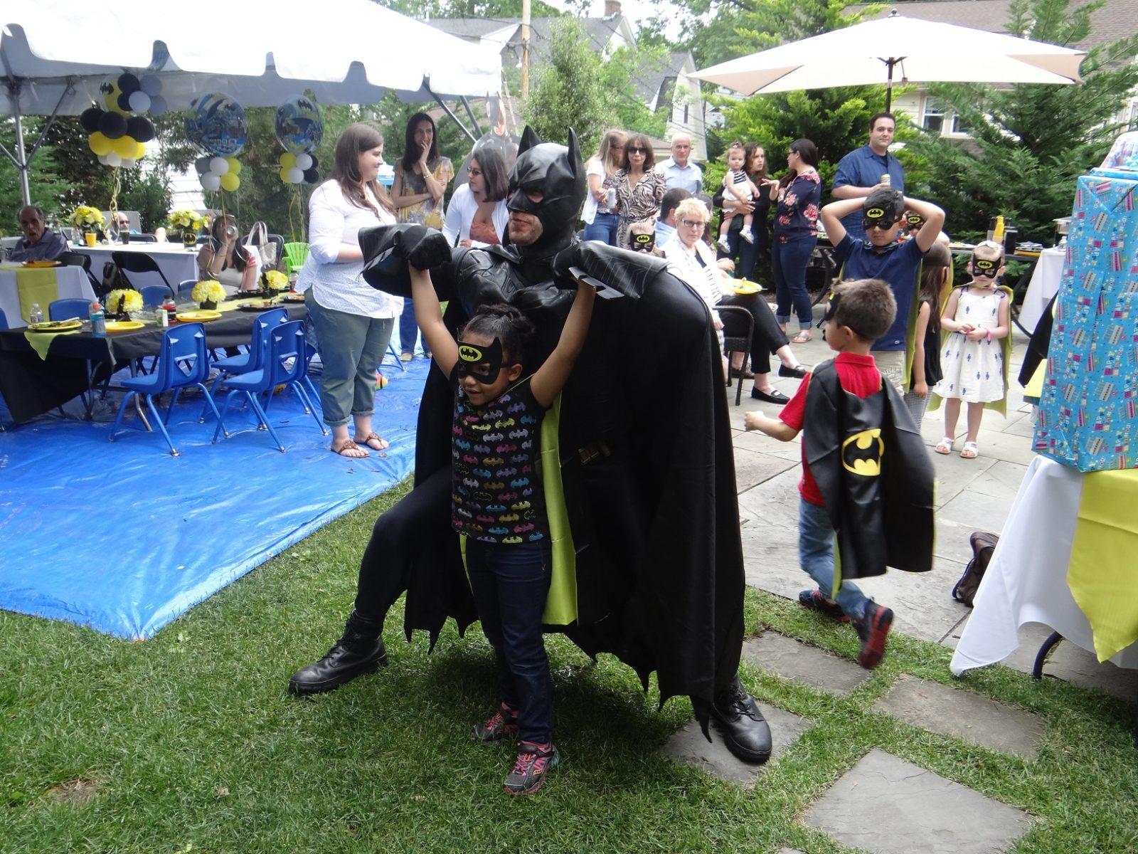 Batman super hero pose at birthday party