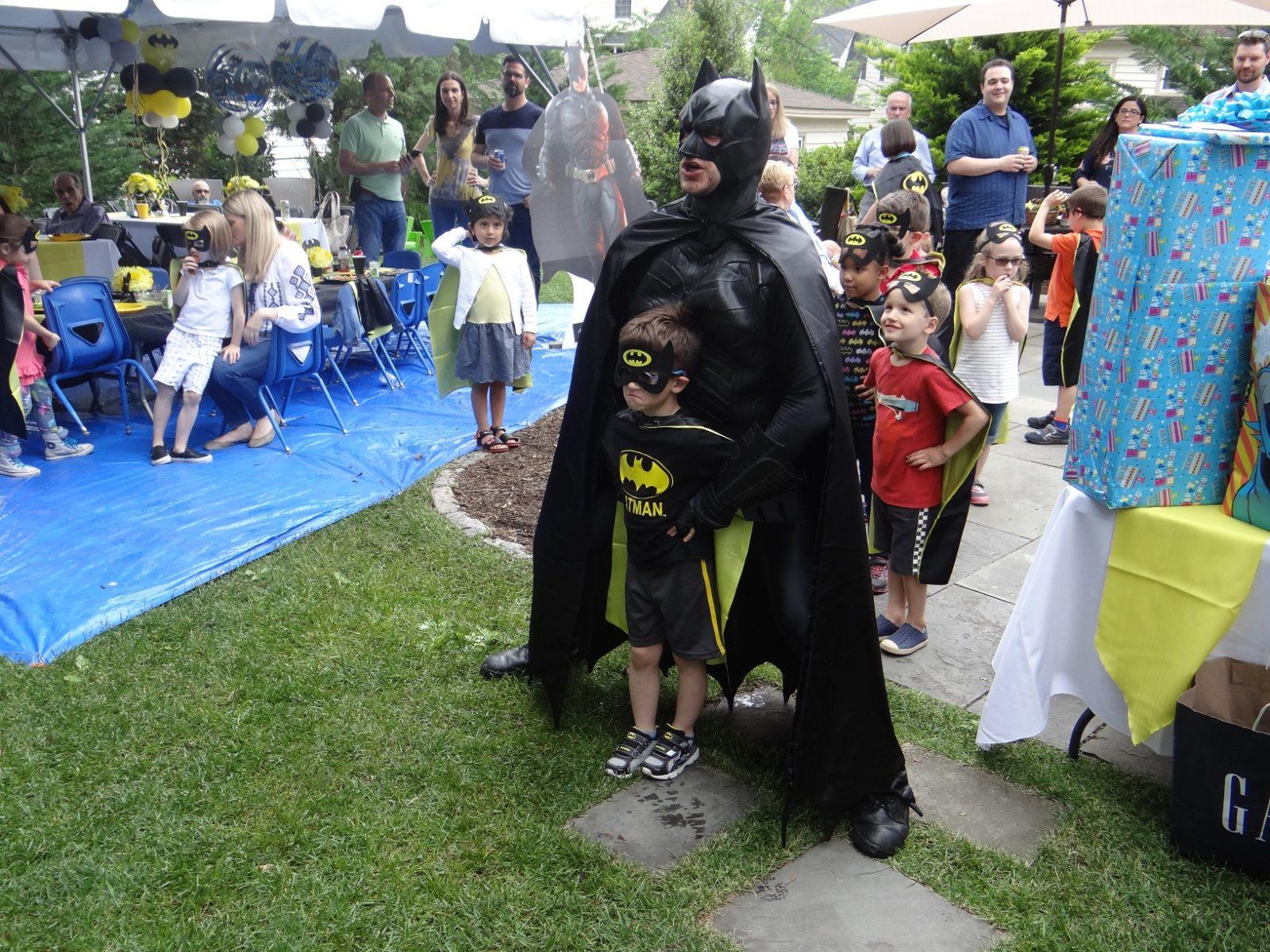 Batman and little batman stricking a pose for the camara