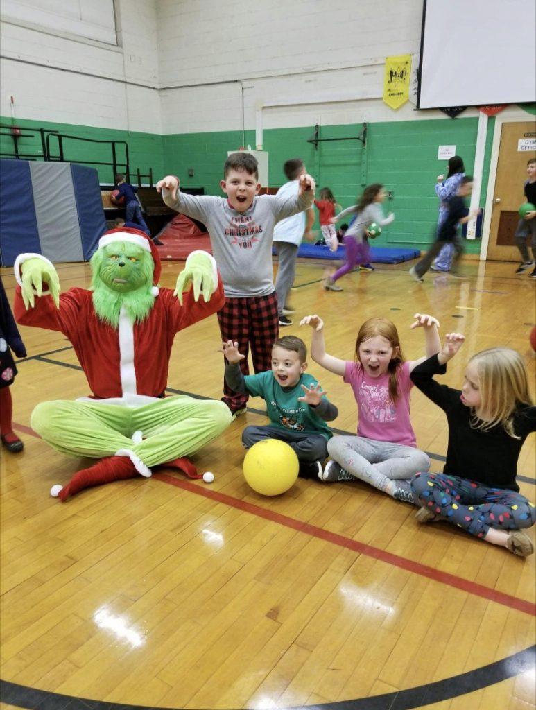 Grinch visits frenklin school Christmas eve.