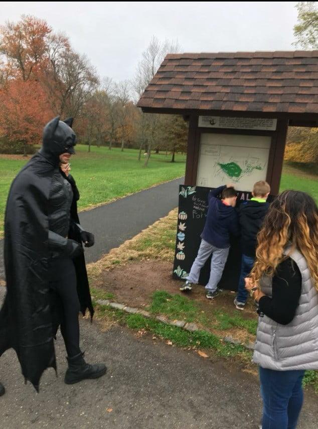 Bat Man running through park
