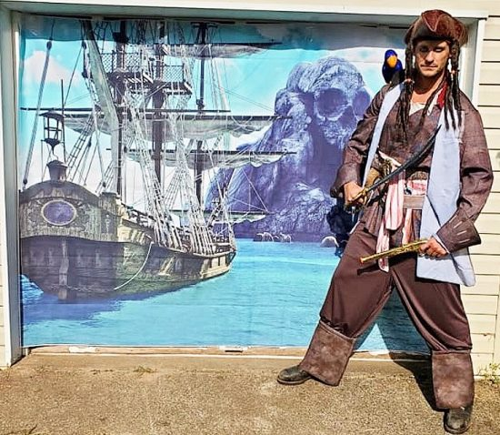pirate with pirate ship backdrop