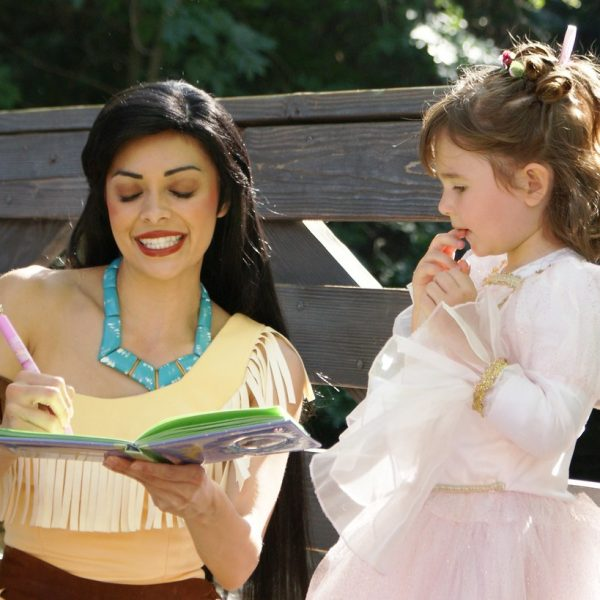 Pocahontas reads fairytail book at kids birthday party