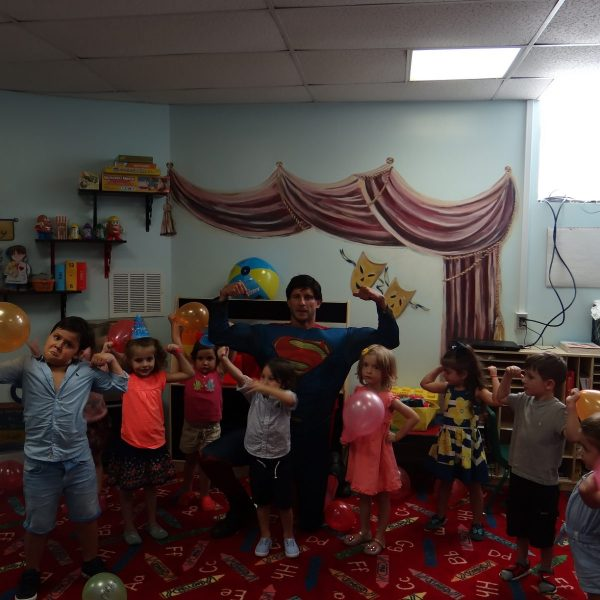 Superman double bicep at school birthday party