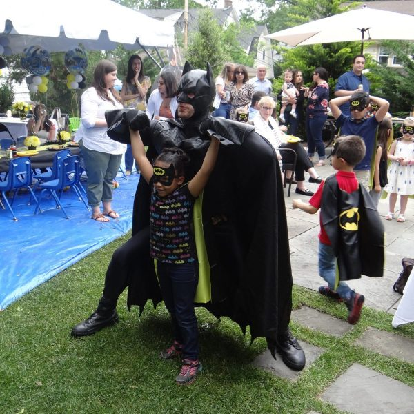 Batman super hero pose at birthday party