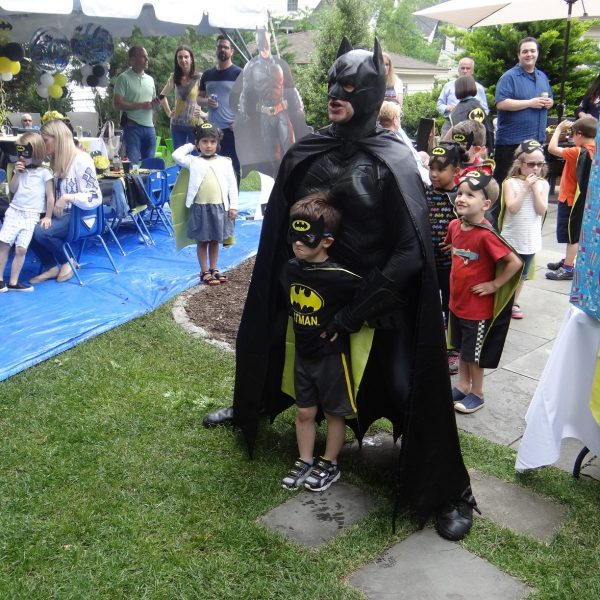 Batman and little batman stricking a pose for the camara