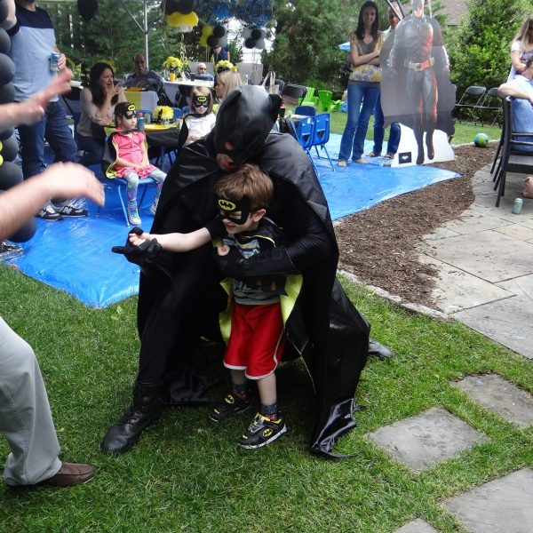 Batman and little batman shooting the cable at the birthhday party
