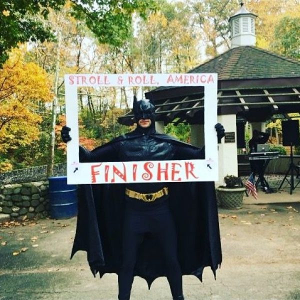 Batman is a finisher at the walk a thon charity