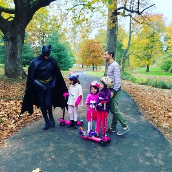 Bat Man running through the park