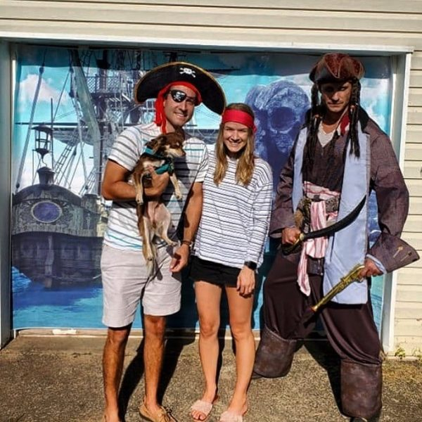pirates posed with puppy