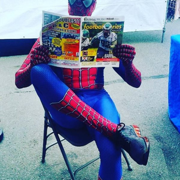 Spider Man reads paper